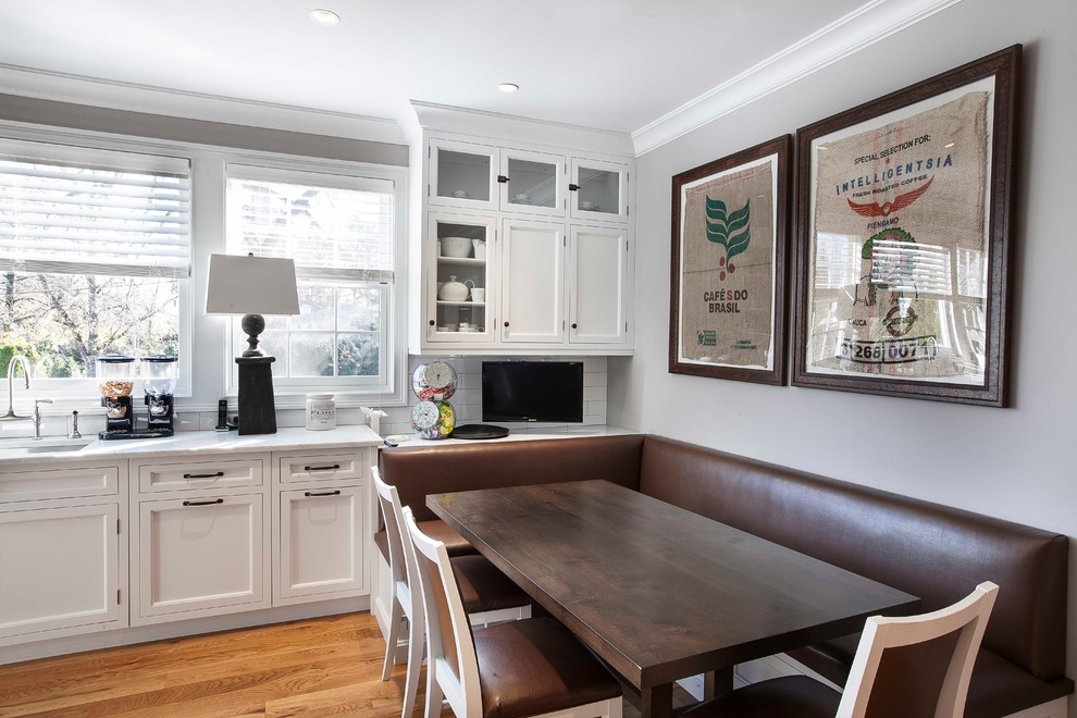 Example of a transitional eat-in kitchen design in New York with an undermount sink, recessed-panel cabinets, white cabinets, white backsplash and subway tile backsplash