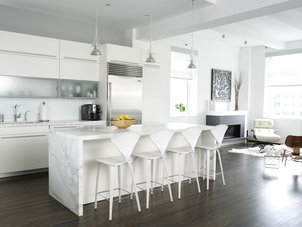 Example of a trendy open concept kitchen design in New York with glass-front cabinets, white cabinets, marble countertops, stainless steel appliances and gray countertops