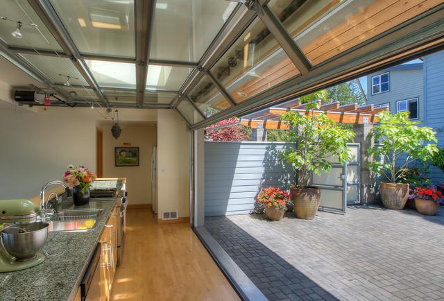 Courtyard kitchen with door up. beach-style-kitchen