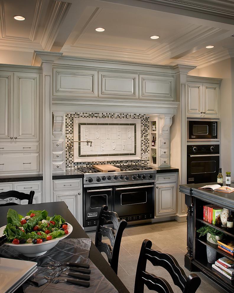 Elegant kitchen photo in Phoenix with black appliances