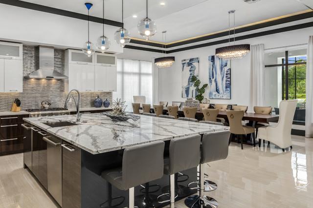 Open concept kitchen - large modern u-shaped porcelain floor open concept kitchen idea in Orlando with a drop-in sink, flat-panel cabinets, dark wood cabinets, quartz countertops, metallic backsplash, glass tile backsplash, stainless steel appliances and an island