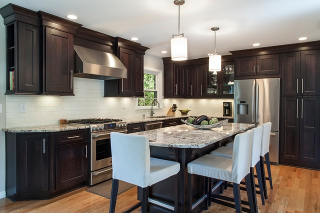 Kitchen with dark cabinets and light floor make for a classy kitchen