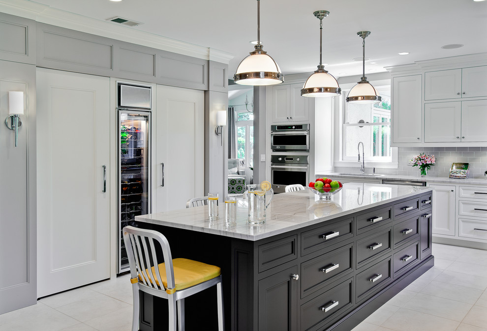 Elegant kitchen photo in Chicago with subway tile backsplash and quartzite countertops
