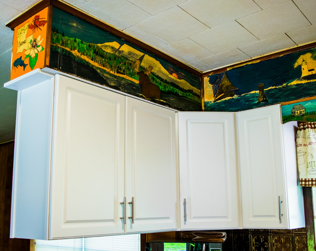 Enclosed kitchen - mid-sized traditional u-shaped brown floor enclosed kitchen idea in New Orleans with a drop-in sink, raised-panel cabinets, white cabinets, granite countertops, brown backsplash, metal backsplash, stainless steel appliances and no island