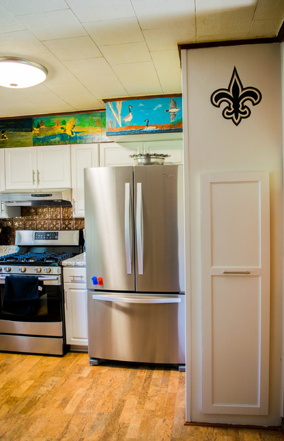 Example of a mid-sized classic u-shaped brown floor enclosed kitchen design in New Orleans with a drop-in sink, raised-panel cabinets, white cabinets, granite countertops, brown backsplash, metal backsplash, stainless steel appliances and no island