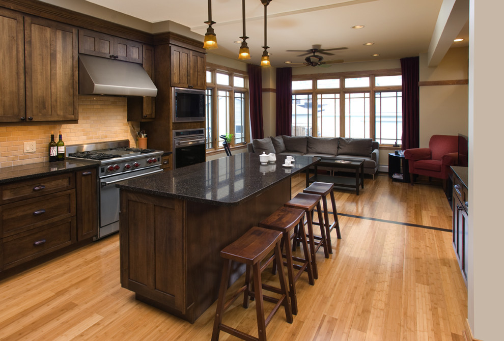 Example of a classic kitchen design in Chicago with granite countertops