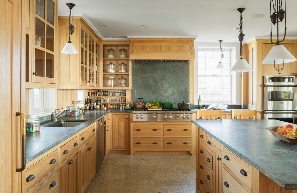 Example of a classic l-shaped enclosed kitchen design in Portland Maine with an undermount sink, medium tone wood cabinets, stone slab backsplash, stainless steel appliances, green backsplash, shaker cabinets and soapstone countertops