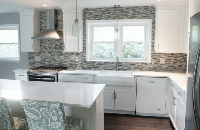 Inspiration for a mid-sized transitional l-shaped vinyl floor and brown floor eat-in kitchen remodel in Philadelphia with a farmhouse sink, shaker cabinets, white cabinets, quartz countertops, blue backsplash, mosaic tile backsplash, stainless steel appliances and an island