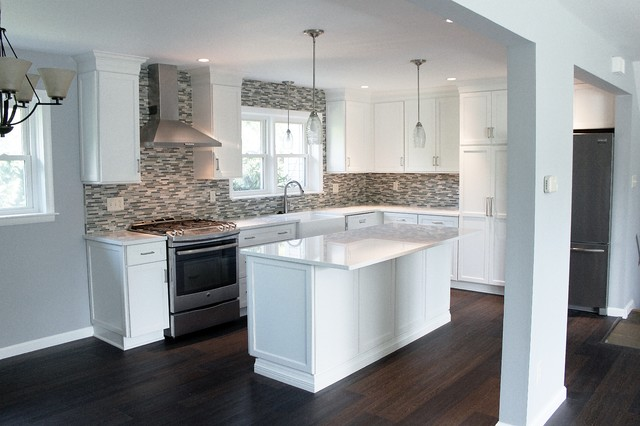 Eat-in kitchen - mid-sized transitional l-shaped vinyl floor and brown floor eat-in kitchen idea in Philadelphia with a farmhouse sink, shaker cabinets, white cabinets, quartz countertops, blue backsplash, mosaic tile backsplash, stainless steel appliances and an island