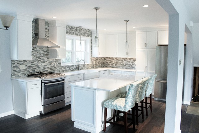 Example of a mid-sized l-shaped vinyl floor and brown floor eat-in kitchen design in Philadelphia with a farmhouse sink, shaker cabinets, white cabinets, quartz countertops, blue backsplash, mosaic tile backsplash, stainless steel appliances and an island