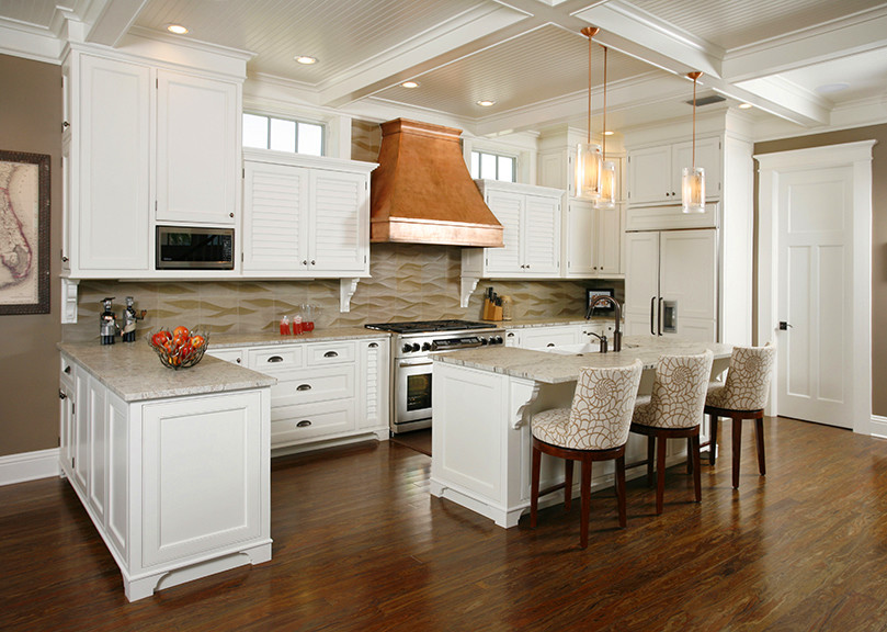 Inspiration for a coastal u-shaped open concept kitchen remodel in Tampa with a farmhouse sink, louvered cabinets, white cabinets, granite countertops, stone tile backsplash and paneled appliances