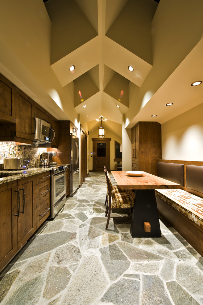 Inspiration for a rustic kitchen remodel in Vancouver with stainless steel appliances