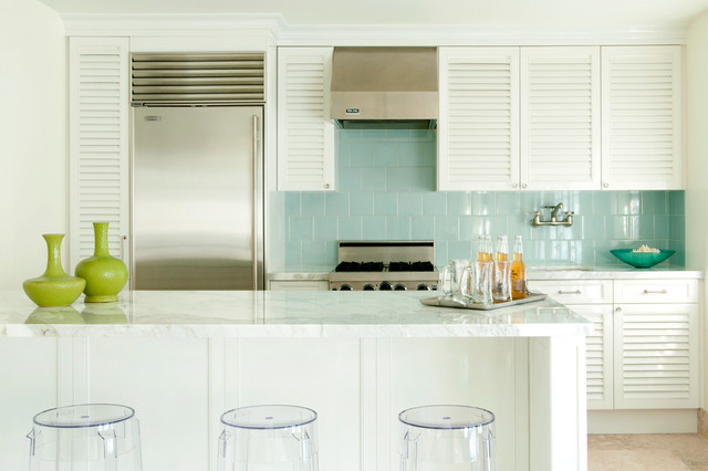 Trendy single-wall kitchen photo in Miami with stainless steel appliances, louvered cabinets, white cabinets, blue backsplash and ceramic backsplash