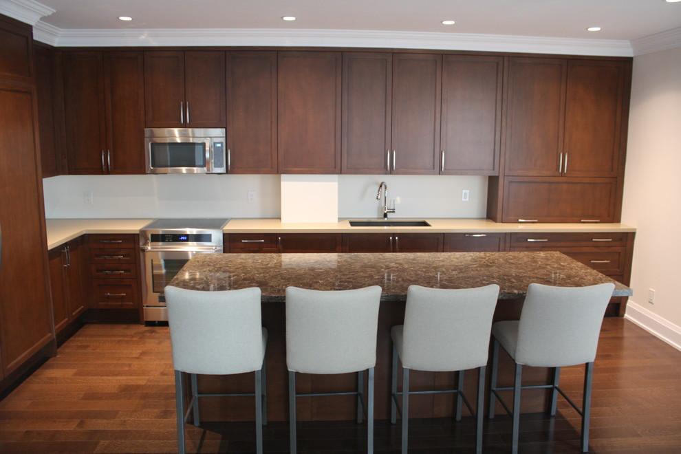 Mid-sized elegant l-shaped medium tone wood floor eat-in kitchen photo in Toronto with an undermount sink, shaker cabinets, medium tone wood cabinets, quartz countertops, brown backsplash, glass sheet backsplash, stainless steel appliances and an island