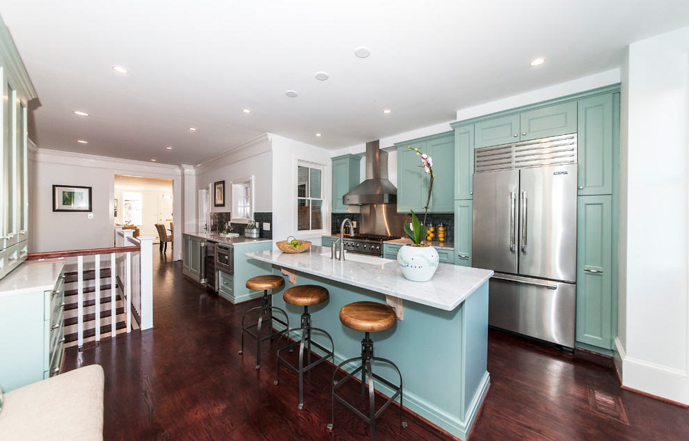 Transitional galley kitchen photo in DC Metro with a farmhouse sink, recessed-panel cabinets, green cabinets, metallic backsplash and stainless steel appliances