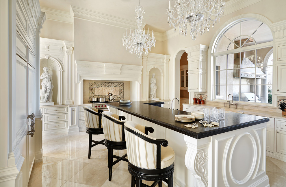 Kitchen - traditional kitchen idea in Phoenix with raised-panel cabinets, beige cabinets, multicolored backsplash, stainless steel appliances and an island