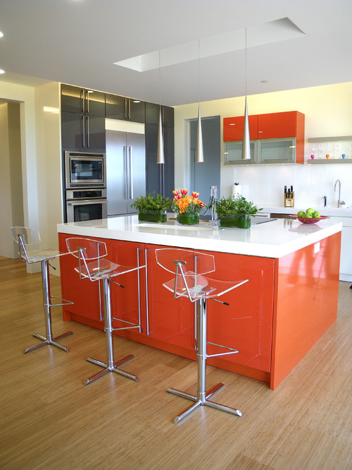 orange and white kitchen counters paired with clear stools