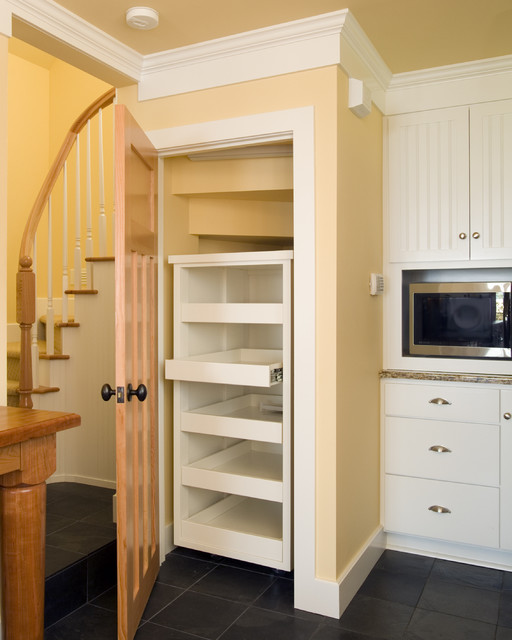 Kitchen pantry built in under the stair with with pullout