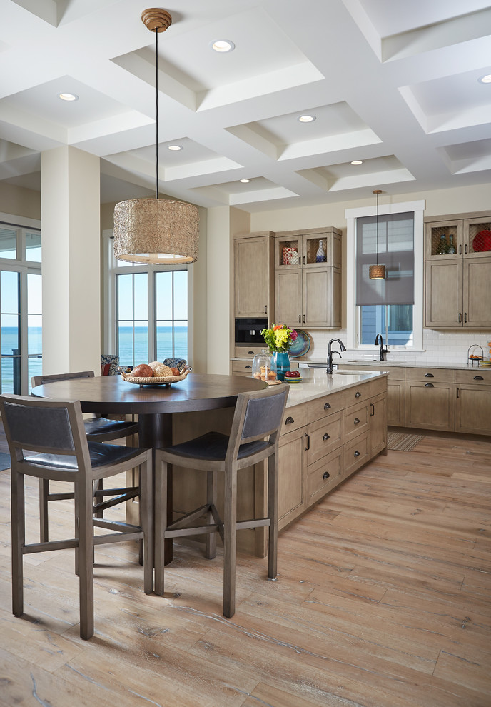 Mid-sized transitional l-shaped light wood floor eat-in kitchen photo in Grand Rapids with an undermount sink, shaker cabinets, light wood cabinets, white backsplash, subway tile backsplash, an island, granite countertops and paneled appliances
