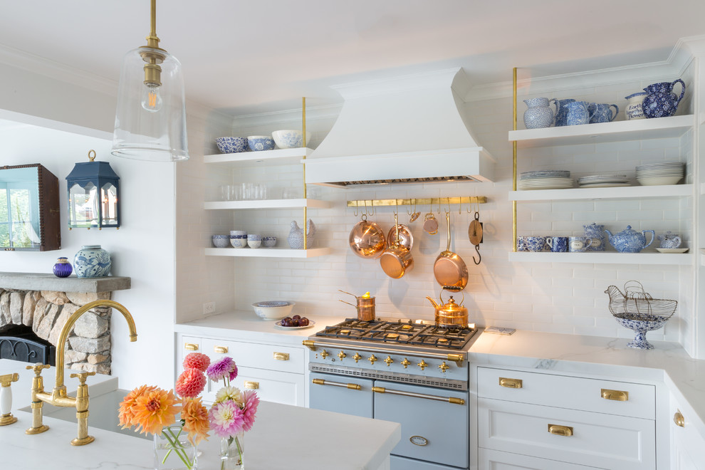 Transitional l-shaped open concept kitchen photo in New York with recessed-panel cabinets, white cabinets, white backsplash, subway tile backsplash, colored appliances, an island and white countertops