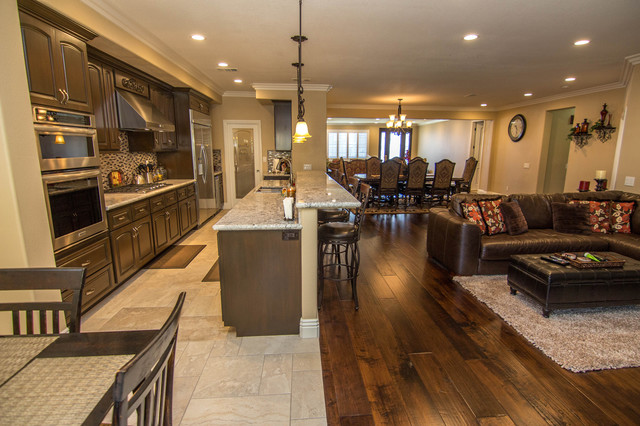 Example Of A Large Transitional Travertine Floor Open Concept Kitchen Design In Los Angeles With Raised