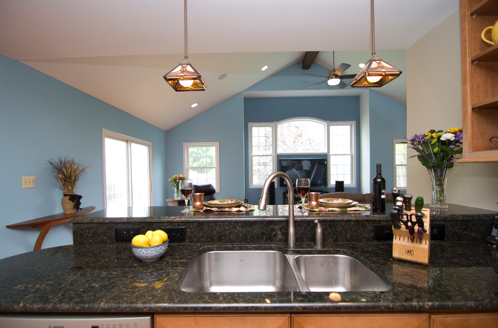 Small elegant u-shaped light wood floor open concept kitchen photo in DC Metro with a double-bowl sink, raised-panel cabinets, light wood cabinets, granite countertops and stainless steel appliances