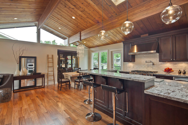 Open concept kitchen with vaulted wood ceiling for Wood floor and ceiling