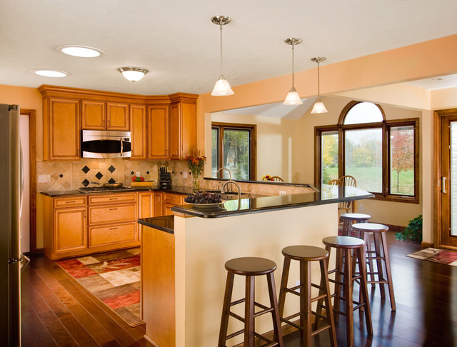 Open kitchen with breakfast bar kitchen cleveland by for Breakfast bar in kitchen designs