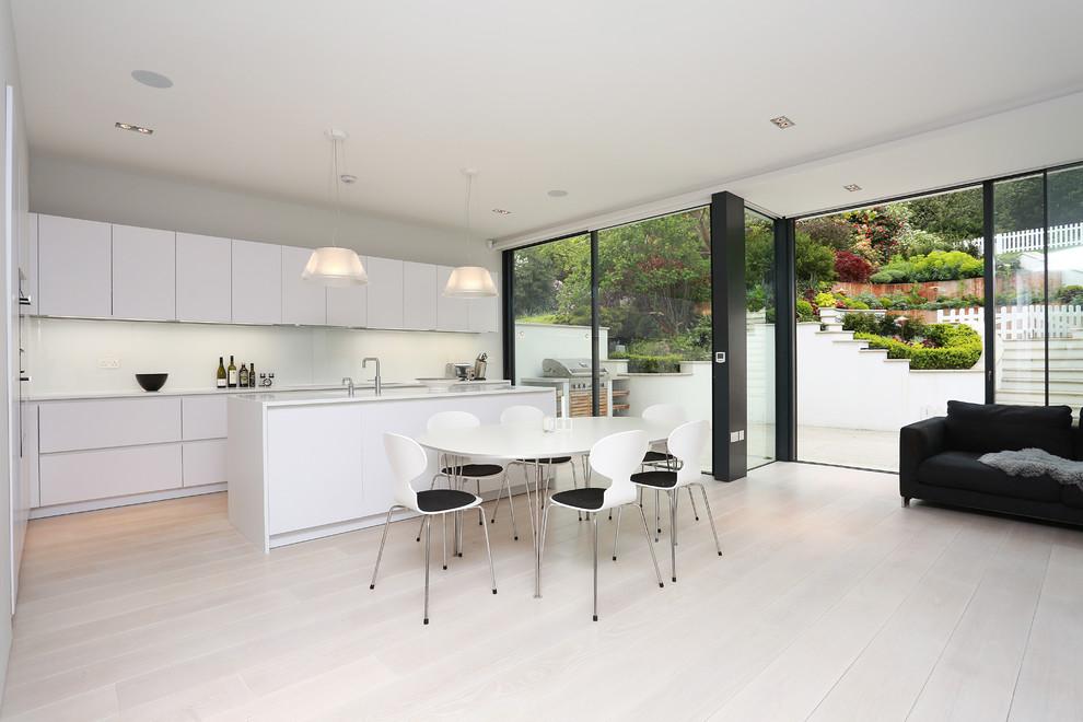 Open plan matt white kitchen
