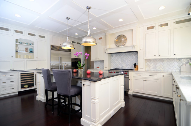 Open plan soft white cabinets contrasting dark floors for Kitchen cabinets with dark floors