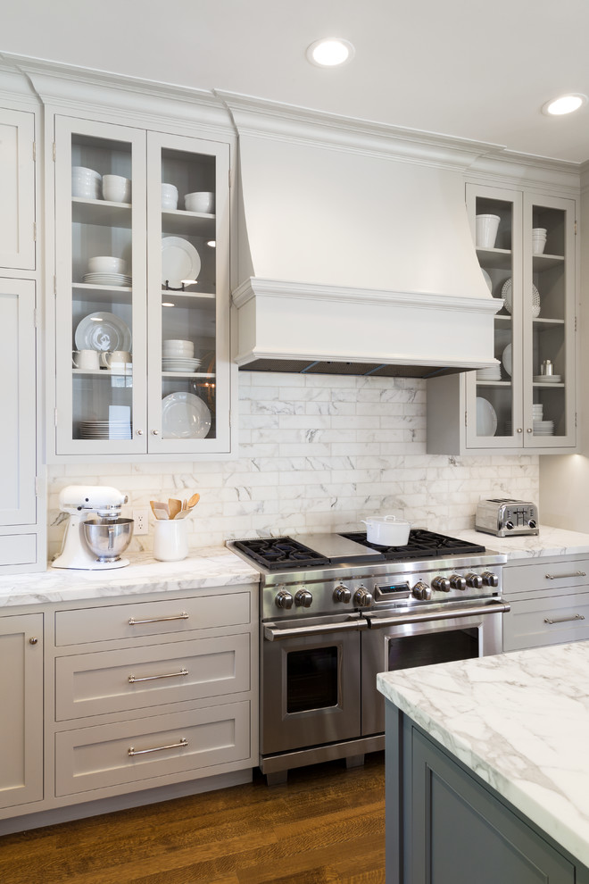 Inspiration for a large coastal medium tone wood floor eat-in kitchen remodel in San Francisco with a farmhouse sink, open cabinets, white backsplash, stainless steel appliances and an island