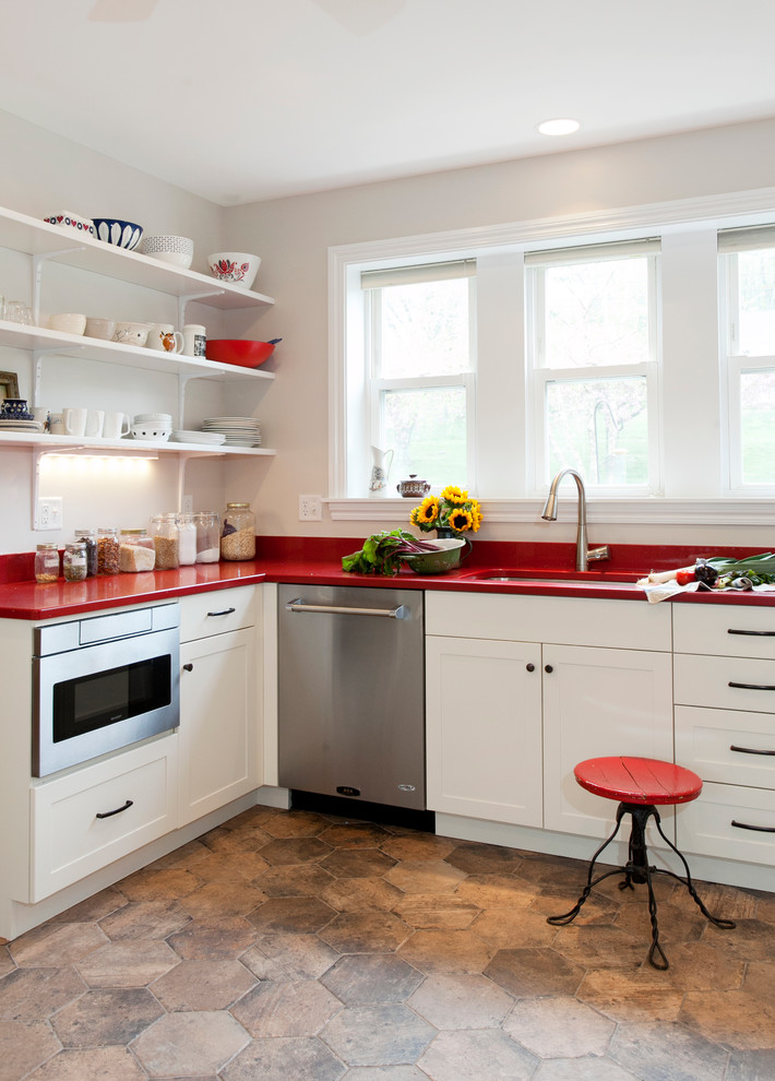 Cottage l-shaped porcelain tile kitchen photo in Bridgeport with an undermount sink, shaker cabinets, white cabinets, quartz countertops, ceramic backsplash, stainless steel appliances and red countertops