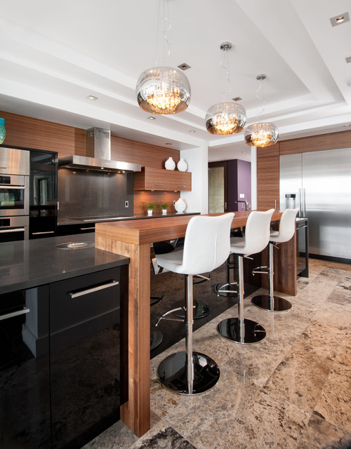 Large trendy l-shaped limestone floor and beige floor open concept kitchen photo in Ottawa with stainless steel appliances, flat-panel cabinets, medium tone wood cabinets, brown backsplash, wood backsplash and an island