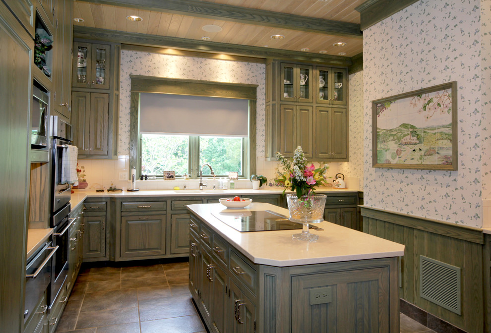 Example of a large farmhouse l-shaped slate floor kitchen design in Richmond with raised-panel cabinets, green cabinets, white backsplash and an island
