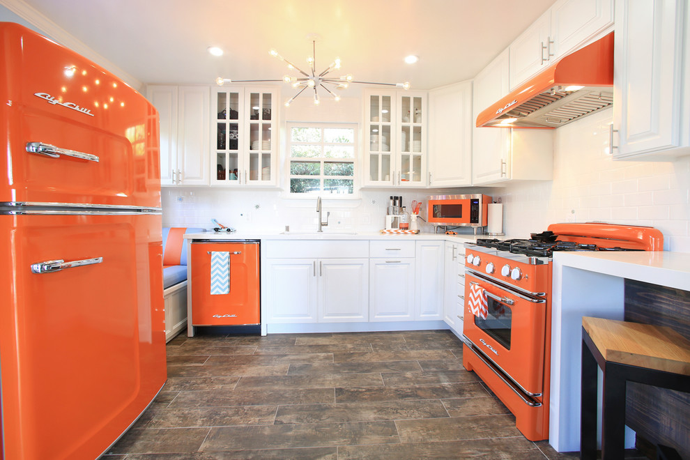 Inspiration for a small transitional porcelain tile eat-in kitchen remodel in Los Angeles with an undermount sink, white cabinets, quartz countertops, white backsplash, subway tile backsplash and colored appliances
