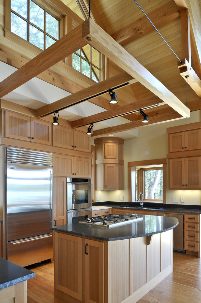 Example of a mountain style u-shaped kitchen design in Seattle with stainless steel appliances, shaker cabinets and medium tone wood cabinets