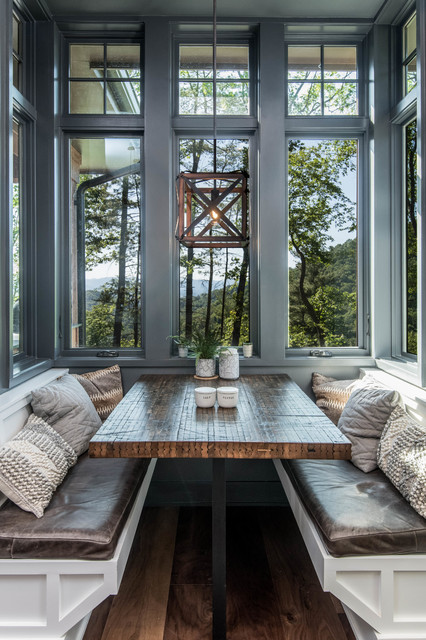 Eat-in kitchen - large rustic l-shaped dark wood floor and brown floor eat-in kitchen idea in Other with an undermount sink, shaker cabinets, white cabinets, granite countertops, white backsplash, window backsplash, stainless steel appliances, an island and black countertops