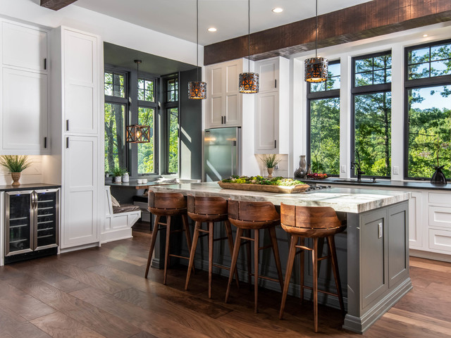Inspiration for a large rustic l-shaped dark wood floor and brown floor eat-in kitchen remodel in Other with shaker cabinets, white cabinets, window backsplash, stainless steel appliances, an island, black countertops, an undermount sink, granite countertops and white backsplash