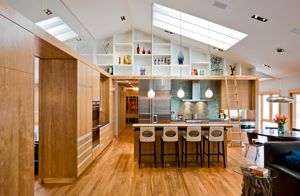 Inspiration for a modern open concept kitchen remodel in Minneapolis with stainless steel appliances, green backsplash, matchstick tile backsplash, flat-panel cabinets and light wood cabinets