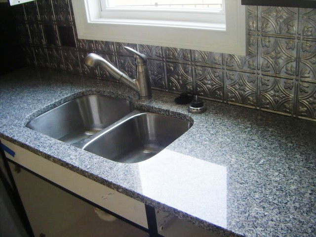 Oriental White Granite Used On White Cabinets