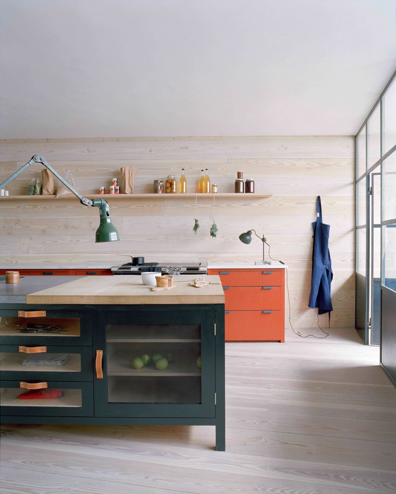 Inspiration for a scandinavian kitchen remodel in London with orange cabinets