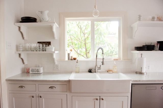 Our bright, white, open kitchen traditional-kitchen