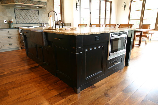 Large arts and crafts l-shaped medium tone wood floor eat-in kitchen photo in San Francisco with a farmhouse sink, beaded inset cabinets, beige cabinets, granite countertops, multicolored backsplash, stone tile backsplash, stainless steel appliances and an island