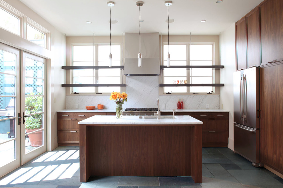 Kitchen - modern l-shaped kitchen idea in San Francisco with recessed-panel cabinets, dark wood cabinets, white backsplash and stainless steel appliances