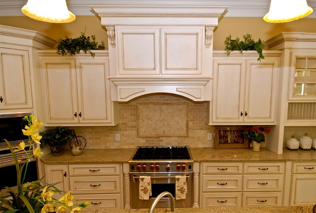 Antique white with chocolate glaze kitchen traditional for Antique white kitchen cabinets