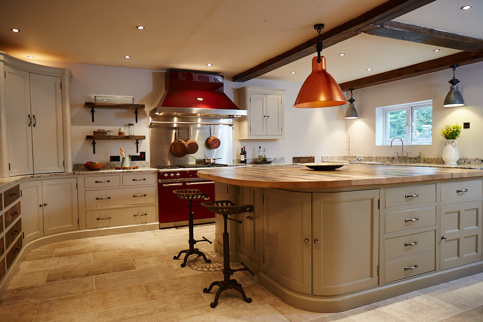 Eat-in kitchen - large traditional l-shaped ceramic floor and beige floor eat-in kitchen idea in Other with an undermount sink, beaded inset cabinets, beige cabinets, wood countertops, gray backsplash, metal backsplash, colored appliances and an island