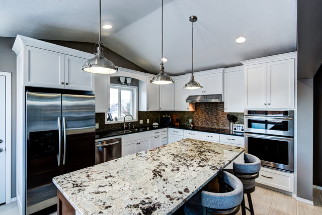 Painted Cabinets With Alaska White Granite On The Island