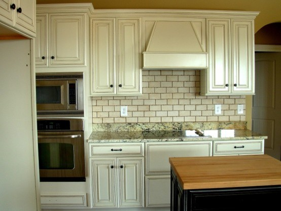 painted distressed kitchen cabinets traditional kitchen by luxe