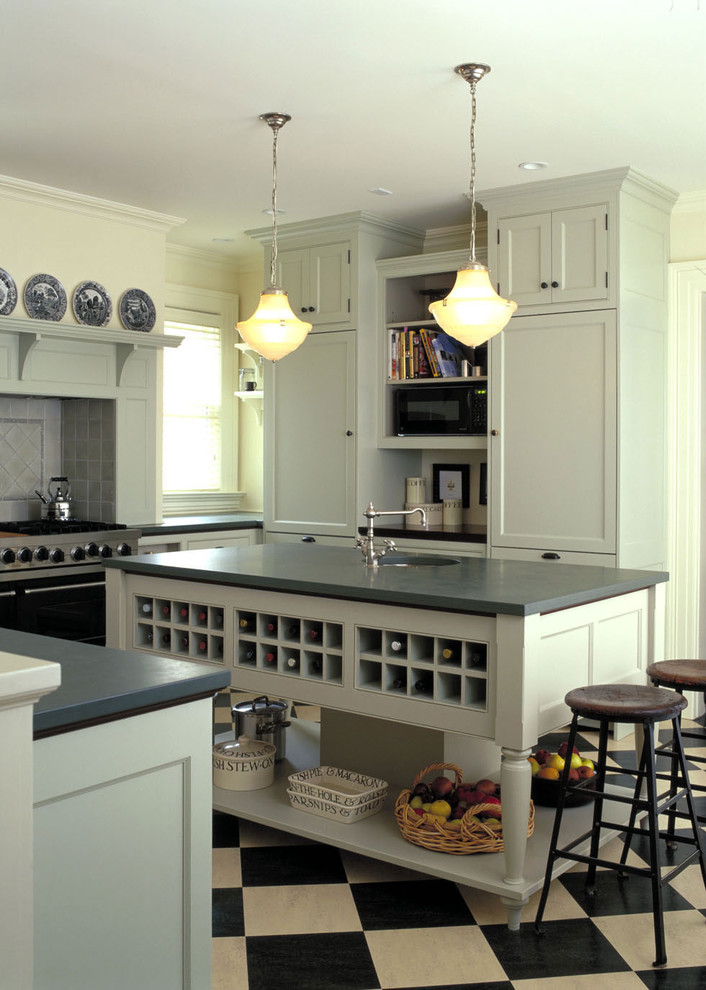 Inspiration for a timeless kitchen remodel in Burlington with recessed-panel cabinets, gray cabinets, black appliances and gray backsplash