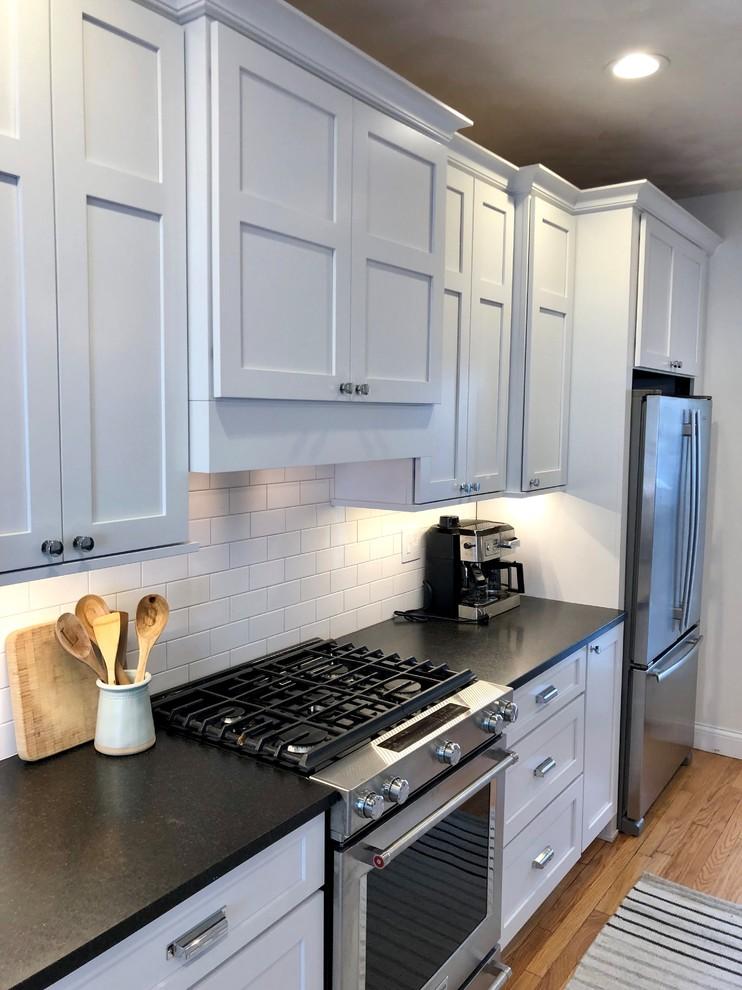 Painted White Koch Savannah Cabinets Black Pearl Honed ...